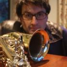 University of Otago student Burt Hatch has to make do with a friend's saxophone after his was...