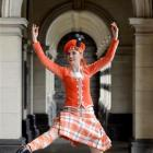 University of Otago student Serena Sangster  dances the Highland reel at Dunedin Railway Station....