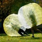 University of Otago students collide in a game of zorb football on the University Union lawn...