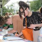 University of Otago students (from right) Anh Hoang and Kimberley Houliston sign a petition...