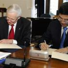 University of Otago vice-chancellor Prof Sir David Skegg (left) and Prof Ming Su, deputy...