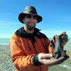 University of Otago zoology department research fellow Dr Nic Rawlence displays a partial femur ...