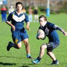 University's Hayden Ladkin, with team-mate Mahara Rudolph in support, makes a break during the...