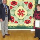 Upper Waitaki RSA president Michael Blackstock and Nick Dempster with  Mrs Dempster's handiwork...