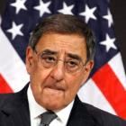 US Defense Secretary Leon Panetta listens to a question about photographs that were published in...