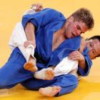 US judoka Nicholas Delpopolo (blue) fights South Korea's Wang Ki-Chun during the men's -73kg...