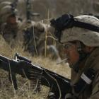 US Marines from 3rd Battalion, 6th Marine Regiment take cover during a firefight as Taliban...