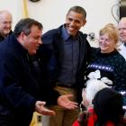 US President Barack Obama (2nd L) and New Jersey Governor Chris Christie (L) talk with survivors...