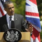 US President Barack Obama gestures during a joint news conference with Britain's Prime Minister...