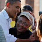 US President Barack Obama hugs a survivor of Hurricane Isaac in LaPlace, Saint John the Baptist...