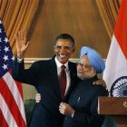 US President Barack Obama, left, and Indian Prime Minister Manmohan Singh, embrace following a...
