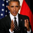 US President Barack Obama speaks during a joint news conference with German Chancellor Angela...