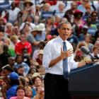 US President Barack Obama talks during a campaign event at Mansfield Central Park in Mansfield,...