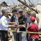 US President Barack Obama talks to residents and views damage from the tornado that devastated...