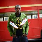 Usain Bolt of Jamaica poses beside a traditional routemaster bus outside the British Museum in...