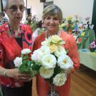Val Clarke, of Oamaru (left), holds her vase of ''Irresistible'', the champion miniature rose,...