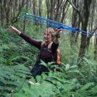 Valerie Fay listens for kiwi signals at Orokonui. Photo by Neville Peat.