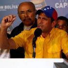 Venezuela's opposition leader Henrique Capriles gestures during a news conference in Caracas...
