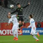 Victor Guzman, of Mexico, outjumps Uruguay's Kevin Mendez (left) as Nahitan Nandez lingers in...