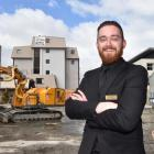 Victoria Hotel duty manager Ben Cochrane stands where a three-storey hotel-expansion will open...