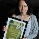 Violet Steed (18) holds her Child, Youth and Family William Wallace Award in her Dunedin flat...