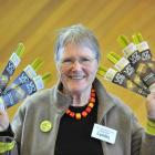 Visual Impairment Charitable Trust Aotearoa trustee Dr Lynley Hood displays Vizbands in the...