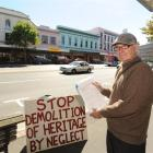 Volunteer Peter Nicholls, of Dunedin, collects signatures for a petition against a proposal to...