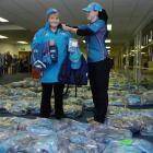 Volunteer VIP driver Sue Lee, of Waikouaiti,  is fitted with her Rugby World Cup volunteer's...