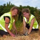 Volunteers Deborah Woodstock (left), from Wiltshire, England, and Shay Munroe, from Virginia,...