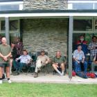 Volunteers take a break during the  painting of the Tautuku Outdoor Education Centre at the...