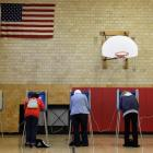 Voters fill out their ballots for the general election in Dearborn, Michigan. AP Photo/Paul Sancya)