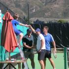 Agreeable ending . . . Josh Roberts (10) shakes hands with New Zealand tennis player Alistair...