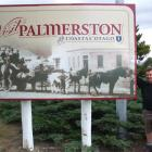 Waihemo Community Board chairman Rod Philip, of Bushey, with the new welcome sign at Palmerston....