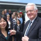 Waitaki Mayor Alex Familton pins a tourism ambassador badge on Amy Choie at Aoraki Polytechnic's...