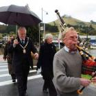 """Waitaki Mayor and mayoress Alex and Heather Familton are piped around the """"new"""" Palmerston stores..."""