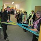 Waitaki Mayor Gary Kircher and his mother Margaret Kircher untie a ribbon to officially open the...