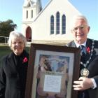 Waitaki Mayoress and Mayor Heather and Alex Familton display the certificate presented to Mr...