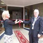 Waitaki MP Jacqui Dean cuts the ribbon to open the Waihemo Heritage Trust museum at Palmerston on...