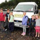 Waitati School pupils ready to board their bus at the school are (from left) James Burchell (9),...