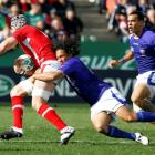 Wales flanker Danny Lydiate is tackled by Samoa's Tasesa Lavea during their Rugby World Cup Pool...