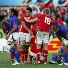 Wales players celebrate after beating Samoa. REUTERS/Bogdan Cristel