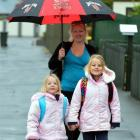 Walking to Musselburgh School yesterday morning are  Imogen (5, left) and Gwendoline (6) Wells...