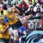 Wallabies' lock Dan Vickerman catches a high ball as teammate Sekope Kepu looks on during their...