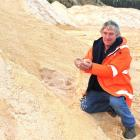 Walton Park sand quarry manager Barney Fuller shows some prized  Dunedin  golden sand. Photo by...