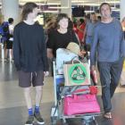 Wanaka family Luke Facer (17), Nina Lunn and Julian Facer, arrive at Dunedin International...