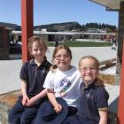 Wanaka Primary School pupils (from left) Madi Loudon  and Maddison Frazer enjoy the first day at...