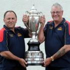 Warren Jones (left) and Colin Ward show off the Bacardi Cup. Photo by Peter McIntosh.
