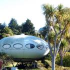 "Warrington's ""flying saucer"" house may be shooting off to a new base on Auckland's beach front...."