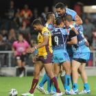 Warriors players celebrate a try during the pre-season game against the Brisbane Broncos at...