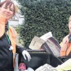 Wastenet Southland waste officers Lee Boyd (left) and Samantha Tulett inspect a recycling bin in...